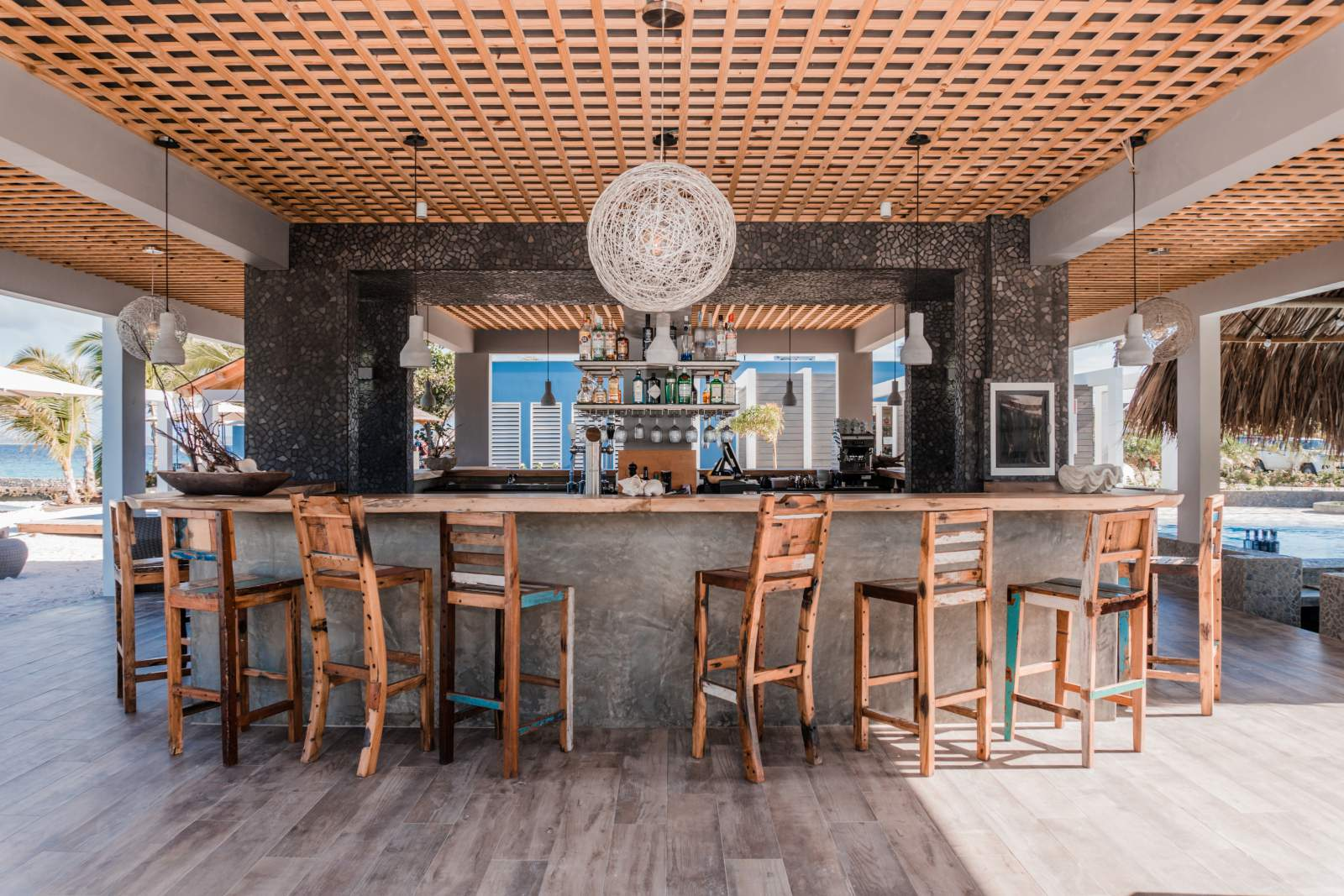 caribbean furniture. Adding The Caribbean Vibe To Bar Of Brass Boer By Placing Furniture Colored, Reclaimed Teak Wood.